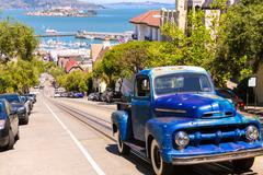 Stock Photo of San Francisco Hyde Street and vintage car with Alcatraz