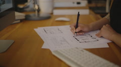 Attractive Young female architect working on blueprint Stock Footage