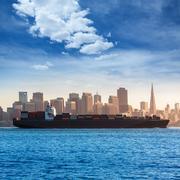 San francisco Skyline with merchant ship cruising bay at Califor - stock photo