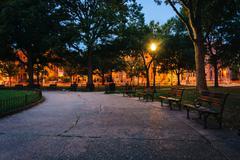 Walkway and benches at Logan Circle at night, in Washington, DC. Stock Photos