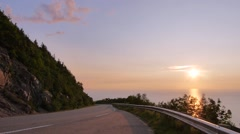 Road Ocean Cliff Cars Sunset Stock Footage