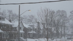 Slow motion snow falling in the street. Toronto, Canada. Stock Footage