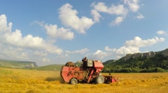 Combine Mowing Grains At Picturesque Place Stock Footage