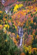 Autumn Bujaruelo Ordesa waterfal in colorful fall forest Huesca - stock photo