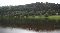 Rain drops in Glendalough Lake Ireland Stock Footage