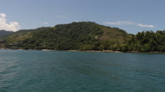 Navigating next to an island in Angra dos Reis, Brazil - stock footage