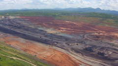 Aerial view shot for Mining dump trucks working in Lignite coalmine lampang thai Stock Footage