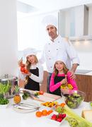 Chef master and junior pupil kid girls at cooking school - stock photo