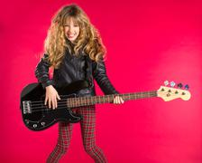 Blond Rock and roll girl with bass guitar on red - stock photo