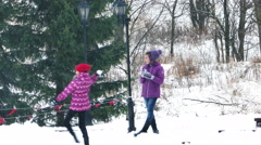 Kids Having Fun and Playing Snowballs in Cold Winter Day Stock Footage