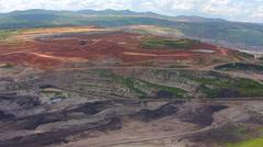Aerial view shot for Mining dump trucks working in Lignite coalmine lampang thai Stock Footage