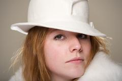 Redhead close-up in white felt hat and fur - stock photo