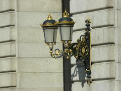 Royal Palace electric wall lamp with crown on top - stock photo