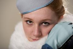 Redhead close-up in blue felt hat and fur Stock Photos