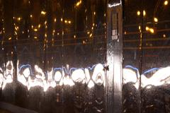 Headlights shining on door in advertising hoarding - stock photo