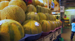 Fresh fruit and vegetable shop - big stack of melons Stock Footage
