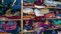 Indian Style Clothes, Folded on Shelves in a Shop Stock Footage