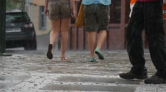 Three Women And Man Walk On The Wet Sidewalk In The Rain To The Right Of Them Stock Footage