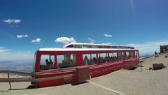 4K Cogwheel tram arriving at top of Pikes Peak - stock footage