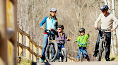 lifestyle leisure Caucasian family parents children bicycle vacation outdoor - stock footage
