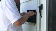 Elderly man picking up mail - stock footage