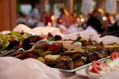 Grilled vegetables in restaurant buffet with diners Stock Photos