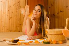 Woman relaxing in sauna. Spa wellbeing. - stock photo