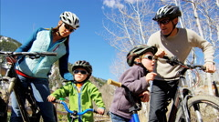 Caucasian family bicycle children boys healthy outdoor lifestyle fitness travel Stock Footage