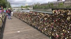 Some of padlocks on the Pont des Arts bridge (in 4k), Paris, France. - stock footage