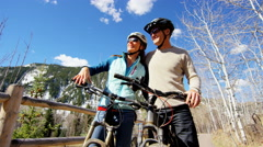 couple Caucasian male female lifestyle cycling together healthy outdoor tourism - stock footage