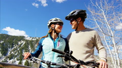 Caucasian male female couple cycling outdoor leisure active travel lifestyle - stock footage