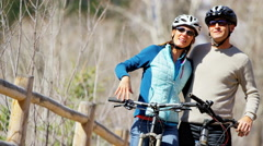 Couple Caucasian male female lifestyle cycling together healthy outdoor tourism Stock Footage