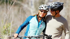Caucasian male female couple cycling outdoor leisure active travel lifestyle Stock Footage