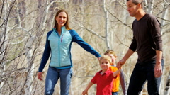 Caucasian family walking park children boys healthy outdoor lifestyle fitness Stock Footage
