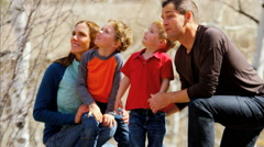 young Caucasian parents sons walking outdoor recreation active teamwork park - stock footage