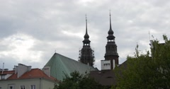 Towers of Cathedral with Crosses Distantly behind the City Houses Roofs Stock Footage