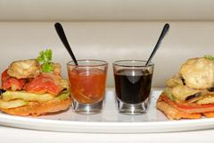 Two sauce glasses between tempura fried vegetables - stock photo