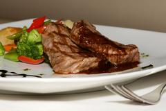 Close-up of filet mignon steak with vegetables - stock photo