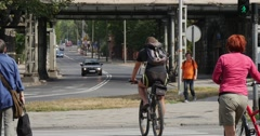 Men Ride On The Bicycles Woman With A Kid On The Baby Seat On The Bicycle Man Stock Footage