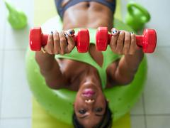 Home Fitness Black Woman Training Pectorals On Swiss Ball Stock Photos