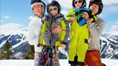 Winter ski skiing vacation Caucasian family parents boys activity snow resort Stock Footage