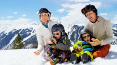 Lifestyle leisure Caucasian family parents children snow vacation outdoor Stock Footage