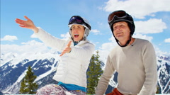 young Caucasian family parents sons outdoor snow ski recreation teamwork - stock footage