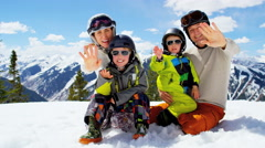 portrait winter ski skiing vacation Caucasian family parents boys snow resort - stock footage