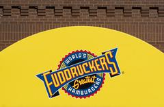 Fuddruckers Restaurant Exterior and Sign. Stock Photos