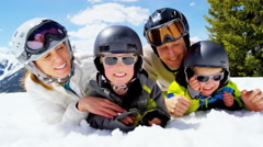Portrait Caucasian family snow mountain skiing children boys outdoor lifestyle Stock Footage