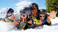 portrait young Caucasian parents sons outdoor snow recreation teamwork - stock footage