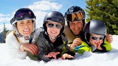 portrait winter ski skiing vacation Caucasian family parents boys snow resort - stock footage