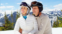 Caucasian male female couple snow winter ski outdoor active leisure lifestyle - stock footage