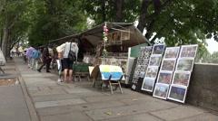 Art stalls on Quai de Montebello (in 4k), Paris, France. Stock Footage